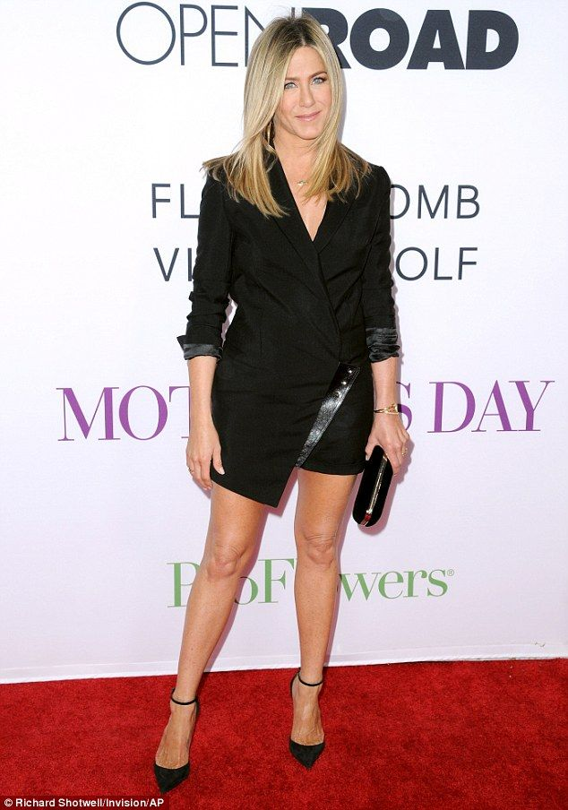 Perfect 10: Jennifer Aniston showed off her trademark legs in a sophisticated black blazer...