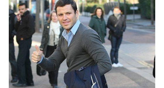 Mark Wright dashes across town to the ITV studios in a light blue shirt and grey jumper which shows off his incredibly muscular arms!