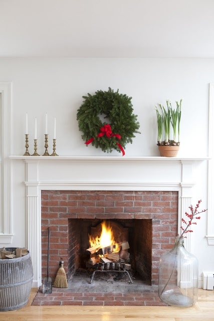 red brick fireplace with white mantle