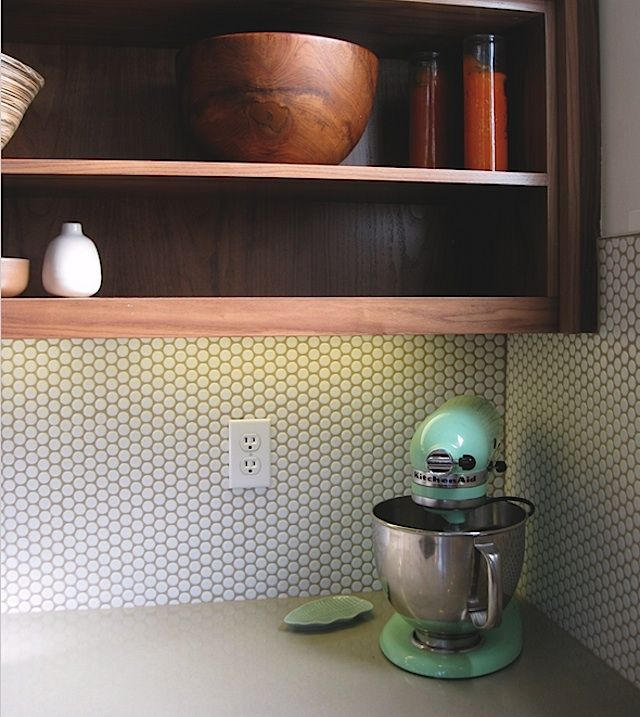 Darker-toned grout is used to highlight white penny-round tiles from Modwalls.