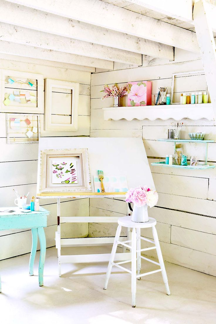 Touches of bold colour in an all-white space is a way to integrate many different hues.