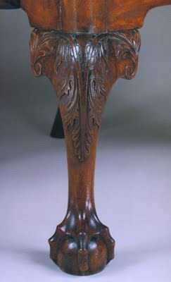Here's some beautiful Chippendale leg detailing (note the ball and claw foot and cabriole leg):