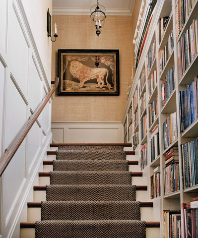 Fabulous staircase - panelling on one side and library on the other (!) - leading up to a great grasscloth hallway with (what appears to to be) a Lion of St. Mark, which I adore. Terrific use of space, and using books as accents of color is not only so smart and wonderful, but such an easy way to show the owners' personality and interests. Ferguson & Shamamian, obviously.