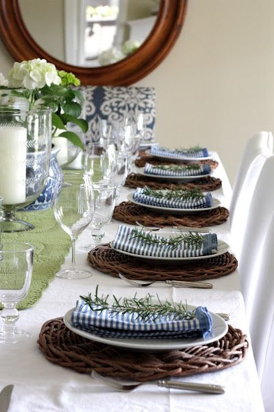 Blue & white table setting, each with a sprig of rosemary.