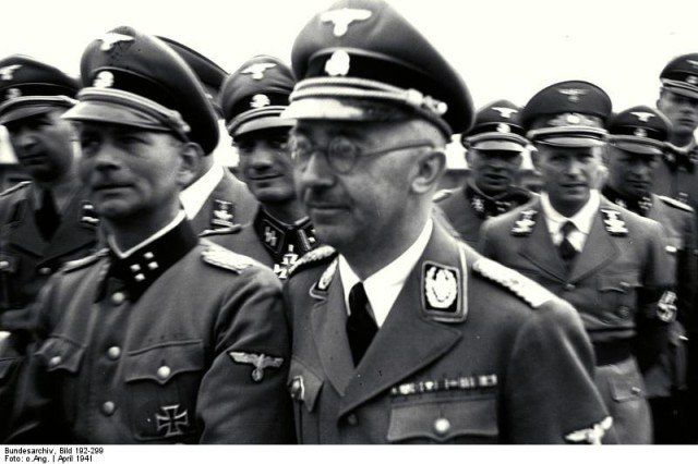 The 1941 SS tour of Mauthausen concentration camp headed by Heinrich Himmler (center). Otto Kumm (front row, left), Wilhelm Bittrich and Paul Hausser, who later became key figures in HIAG, took part.