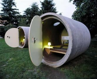 Guest houses made out of concrete pipes. Each pipe has a covering, small vent, bed, and a table lamp. I have to think that it may get a bit cramped while staying there! On the plus side, the weekly rates are probably very reasonable. The bathrooms do present a problem in this design