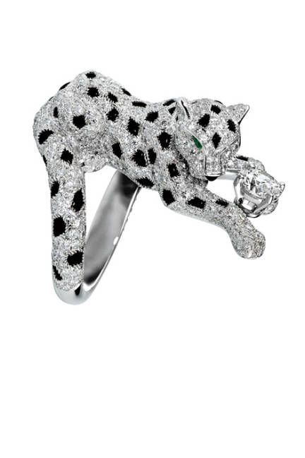 Platinum leopard ring with brilliant-cut diamonds, onyx and emeralds by Cartier