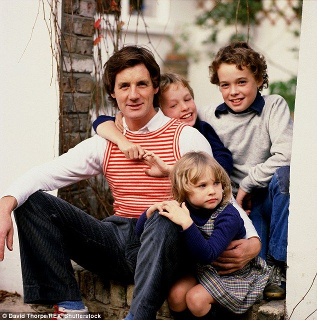 Family portrait:Michael Palin in a garden with his children Tom, William and Rachel in 19...