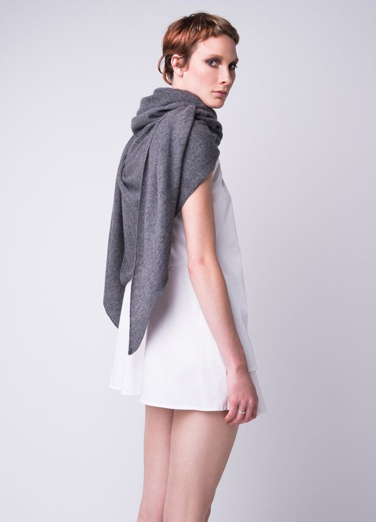 A feather-light oversized cashmere triangle shawl.