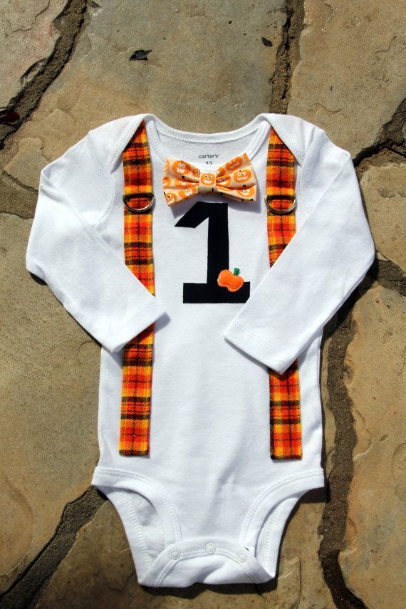 This listing includes the Bow Tie/Suspender bodysuit with the number 1 and pumpkin applique. This bodysuit would be adorable for those Halloween birthday boys!  Find a matching hat here: https://www.etsy.com/listing/247199994/halloween-baby-boy-newsboy-hat-with?ref=shop_home_active_10  You can find leg warmers here: https://www.etsy.com/listing/119402005/baby-button-leg-warmers-pick-your?ref=shop_home_active_8  BODYSUIT SIZE CHART: (Carters size bodysuit)  Newborn: 5-8 lbs, 21.5 L 3 Months…