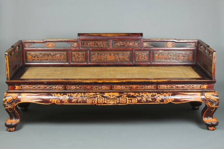 "Lot 1236, A Chinese carved hardwood day bed with pierced panels, raised on cabriole supports 30""h x 77""l x 35""w, est  £150-250"