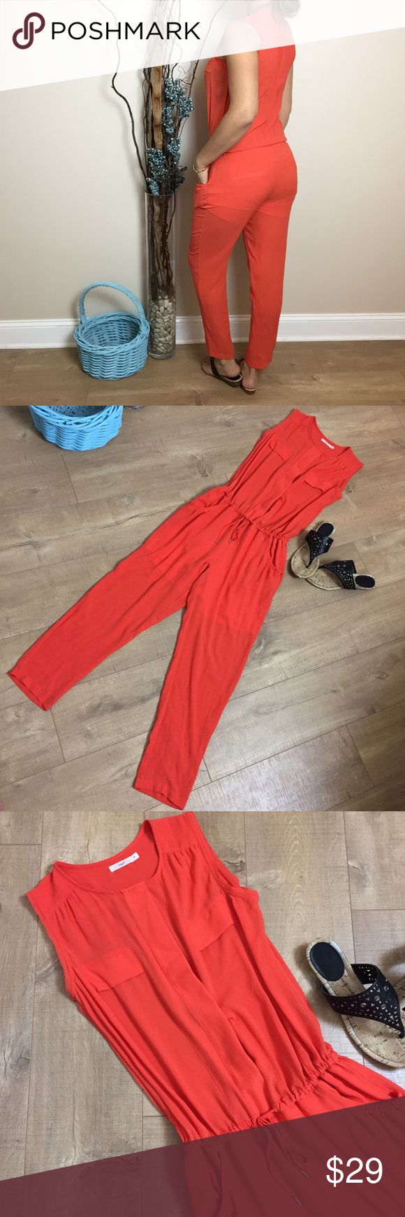 """""""Amy"""" Orange Jumpsuit Sheer orange jumpsuit with pockets & lining, drawstring waist & fitted cut. Dress it up with stilettos for date night! Light mark around one ankle, not noticeable when worn. 65% poly, 35% rayon, Pants Jumpsuits & Rompers"""