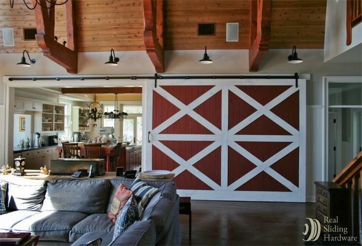 Red barn doors separate living room and kitchen because for Barn doors to separate rooms