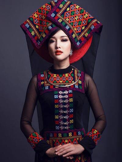 Cyclamen on the mooThe modern Ao Dai (Vietnamese traditional dress) with Khan Pueu (the traditional scarf of black Hmong - Thailand)