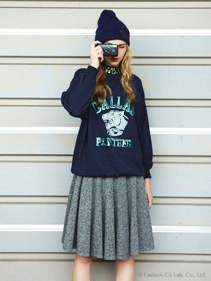 beanie, sweatshirt, and pleated skirt