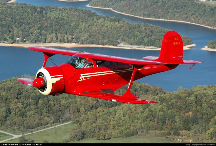 Beechcraft D17S Staggerwing . . .  Here's one in red in case you missed the point