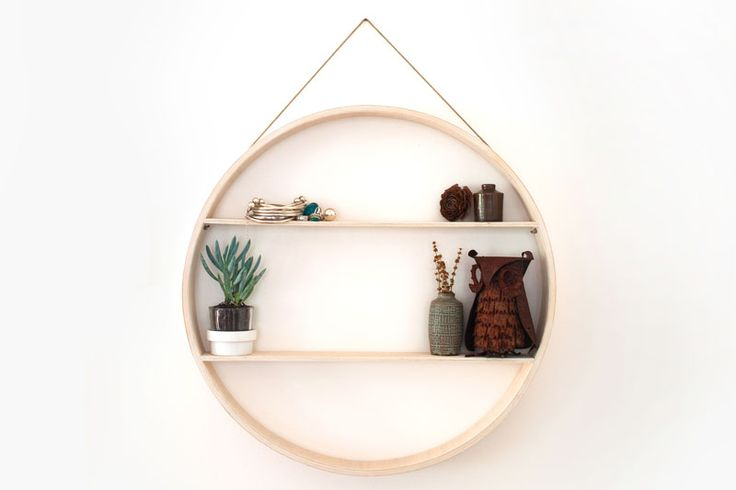 Circular Shadow Box at Booie + Ben. We love this shelf. It looks great in a kids' bedroom, entryway or living area and would suit both vintage or contemporary styles. We also love that it's handcrafted in Australia; there's a definite feel-good factor in giving a gift like this at Christmas time.