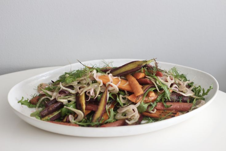 your seasonal vegetable fix is here – with this rainbow roasted carrot with citrus marinated fennel + arugula recipe