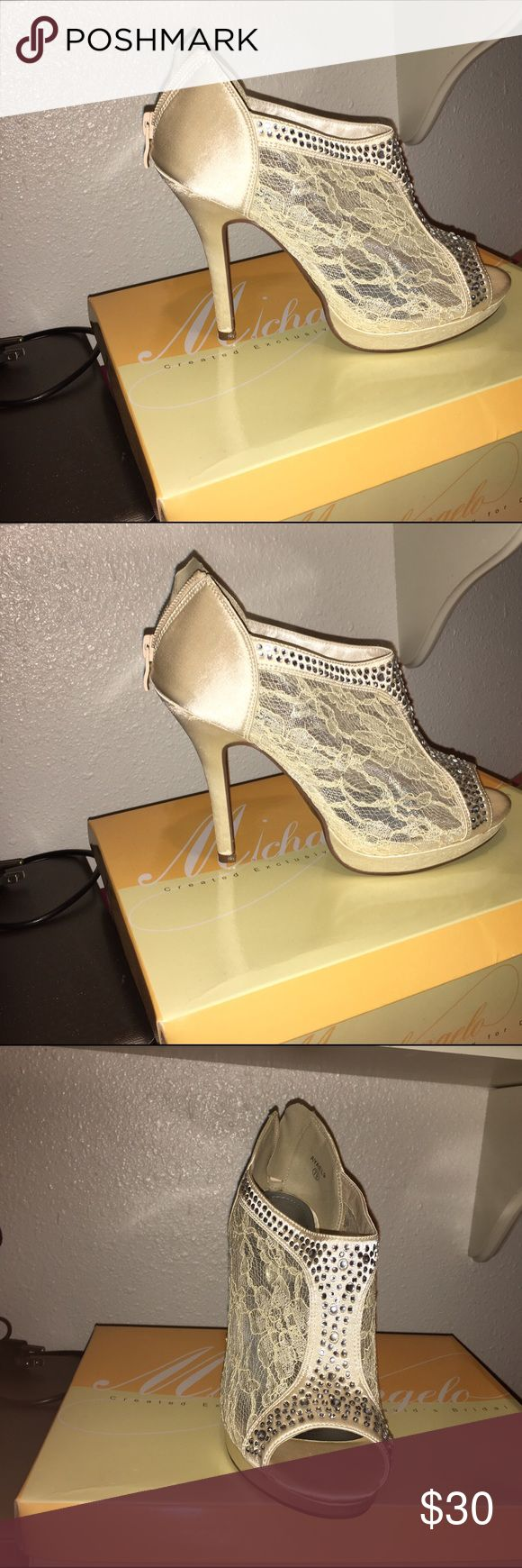 Ivory rhinestone lace bootie Lace booties! Only worn once for a wedding. Some wear & stains due to it being rainy/ dancing worn all day! Come in orginal box! I have 2 pairs of these! David's Bridal Shoes Heels