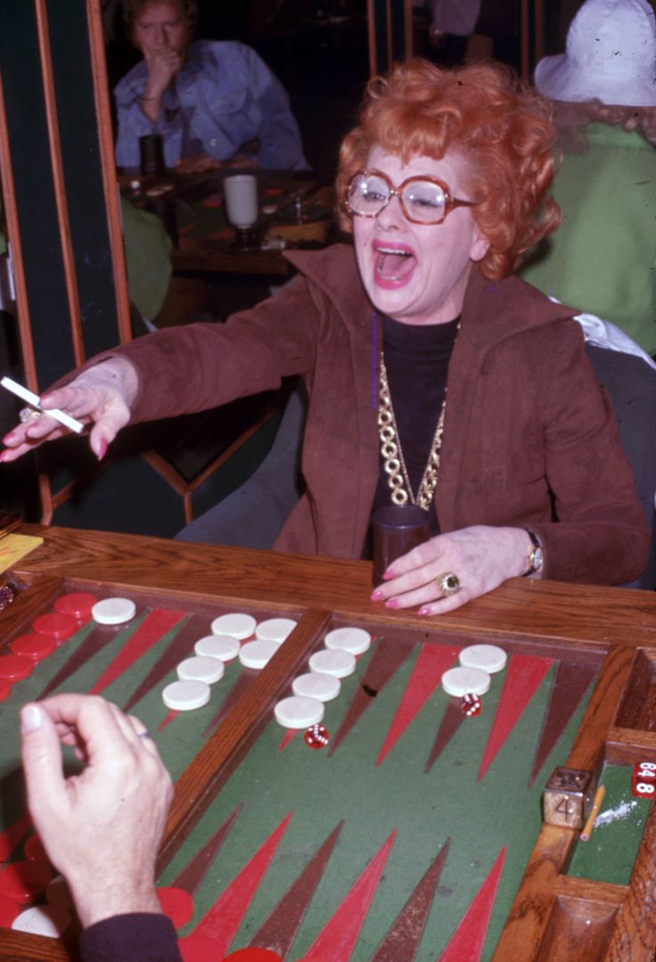1978: Playing a rousing game of backgammon.