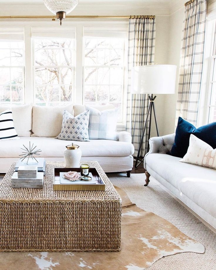 This woven coffee table adds great texture to this space. Love how the hide is laid over a neutral rug.