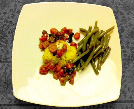 Ricetta Nasello in padella con pomodorini e olive.