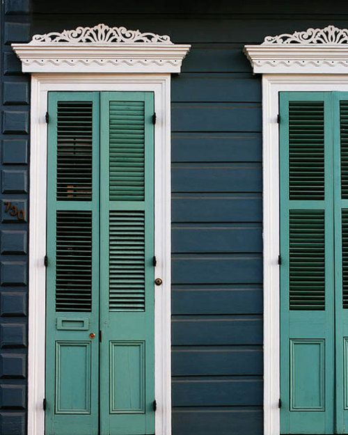 The decorative pediments are wonderful & the shutters & color combination is so nice also.
