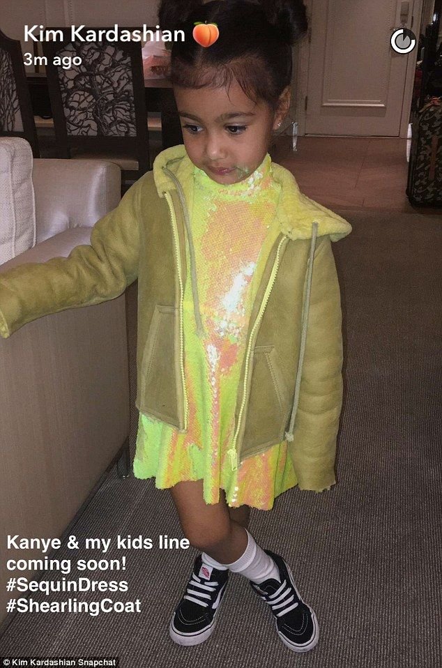 Coming soon! Kim Kardashian West took to Snapchat to unveil she and husband Kanye West's new kids clothing line on Tuesday. North West modeled the first outfit which she helped design