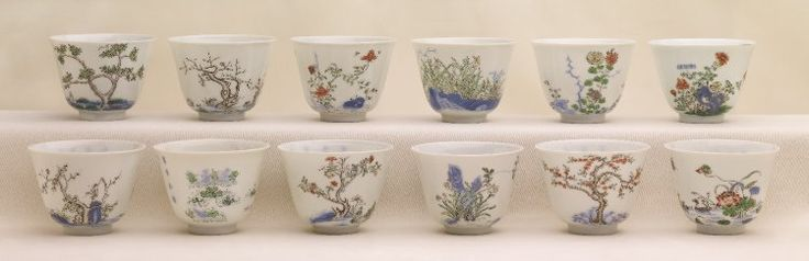 Wucai twelve-months wine cups Set of twelve porcelain wine-cups with deep sides. The wine-cups have a fine white eggshell body. There is a different seasonal tree, shrub or flower, to represent one of the twelve months, in 'famille verte' palette enamel and underglaze blue on the exterior of each cup. PDF 815