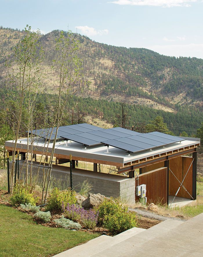 The Solar Revolution installed 3.6-kilowatt photovoltaic solar panels on top of the carport, which sports a board-formed concrete exterior and a cedar-slat-and-plywood interior.  Photo by  David Lauer