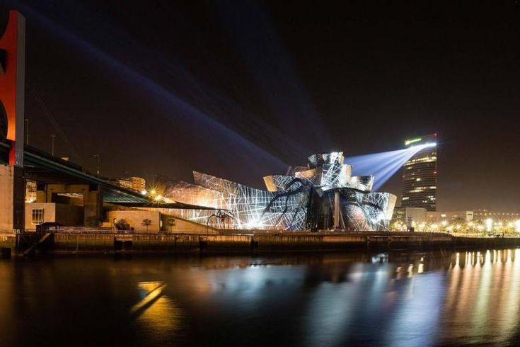 It Was XX Years Ago Today... - the Guggenheim Bilbao opened its doors for the first time. The museum celebrated the 20th anniversary of its Frank Gehry-designed building with a light show gracing the building's titanium skin.
