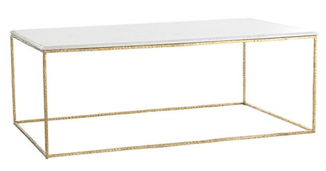 All of the tables I liked were some version of this:  Gold Base with either a marble, glass or mirror top... but goodness... none of them are at all affordable.  This is one of the better priced versions at $899.