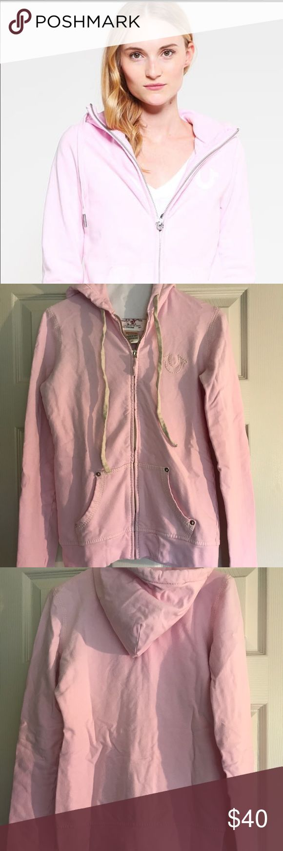 True Religion Women's LNWOT PINK hoodie zip up S/P True Religion Women's Pink Hoodie Zip up in a size S/P. Worn maybe 3 times.  Excellent like new condition, no holes, rips or stains and comes from a smoke and let free home. Perfect for Fall/Winter or as a gift! True Religion Tops Sweatshirts & Hoodies