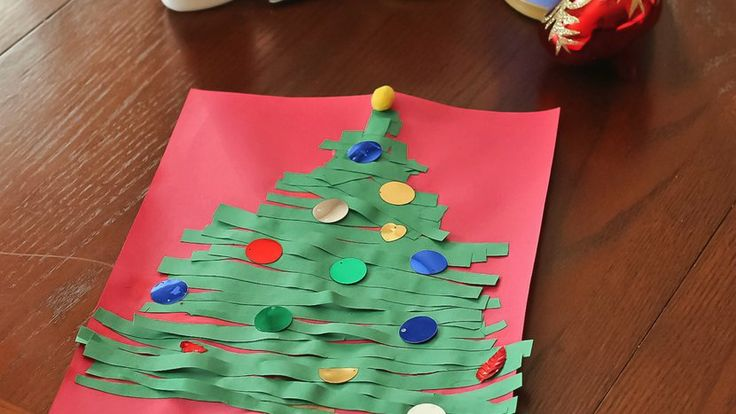 Use strips of green paper to create this simple Christmas Craft with your kids.