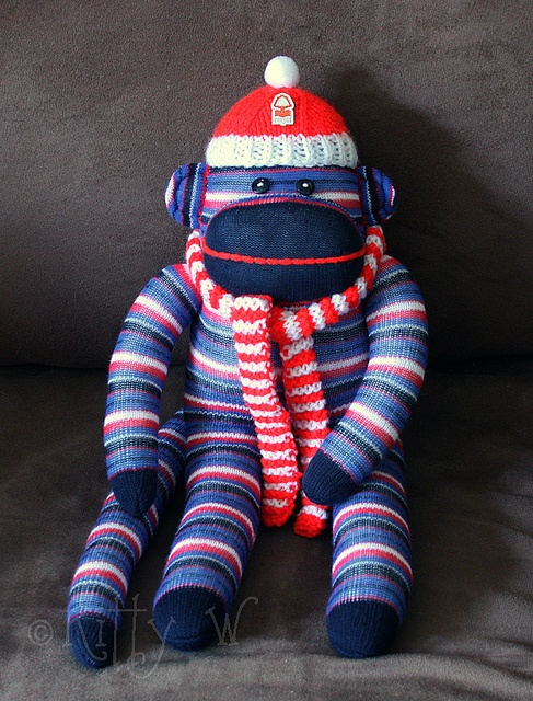 """""""Forest Monkey.  My son wanted a special present to give to his teacher at the end of last term.  He's been with this teacher for two years and they got on so well.  The teacher (Mr O) is an avid supporter of Nottingham Forest Football Club, so I made this sock monkey for my son to give him.    On the monkey's back is a little felt pouch containing a disposable lighter ... because Forest do have a habit of losing their matches ;)"""""""