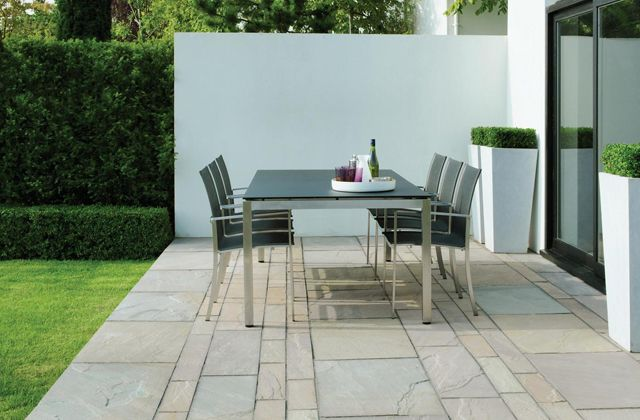 Fusion dining chairs with the stainless steel Kore table by Gloster  http://www.coshliving.com.au/outdoor-brands/gloster/fusion/