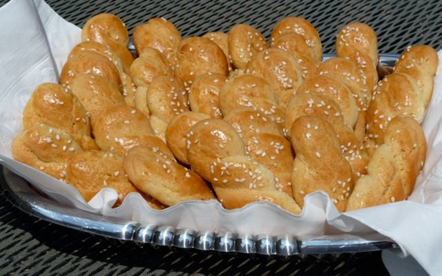 "The name for Koulourakia comes from their round twisted shape but you will also see them shaped as small braids or in the shape of the letter ""S."" traditional Greek Easter cookies. This recipe is close to ours."