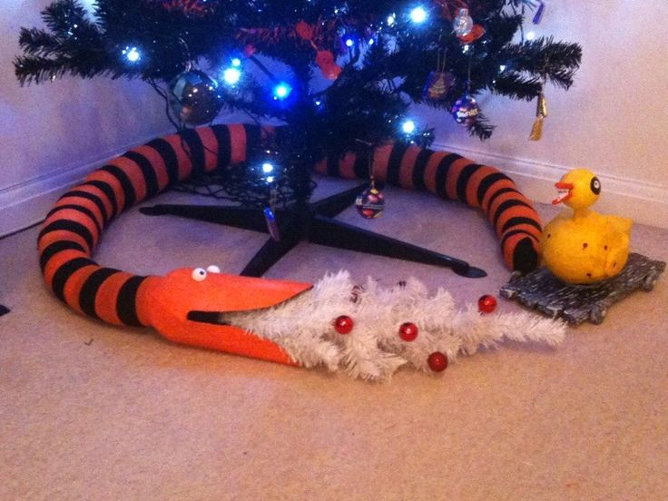 Nightmare Before Christmas snake - orange and black witch tights, stitched 3 or four together and stuffed them with pure white padding from an old cushion.  Head from a balloon papier mache and card. Clay eyes and painted it; mini white tree and glued red baubles on it