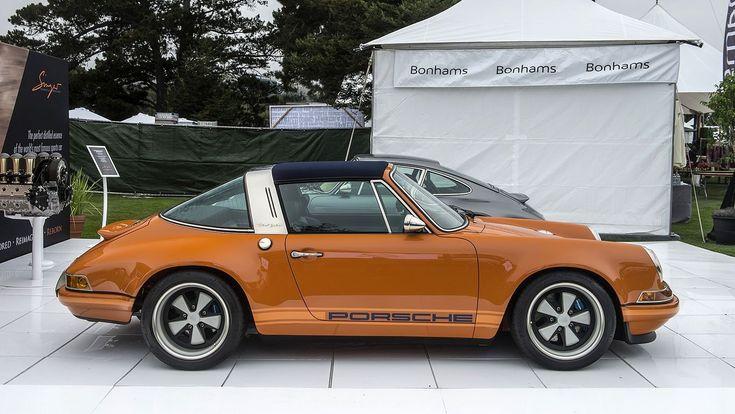 Singer Vehicle Design debuted an orange Porsche 911 Targa and a gunmetal gray coupe recreation at the Quail Motorsports Gathering in Monterey, California.