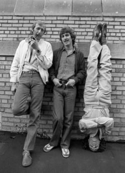 Members of Monty Python (Graham Chapman and Eric Idle) with George Harrison.