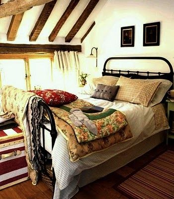 absolutely love this bed and room comfy country bedroom with iron bed frame and mixed linens in lots of time worn patterns
