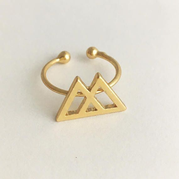 This ring reminds me of a mountain top, of reaching the peak of a journey. The triangle has beautiful symbolism, and these two triangles that come together to make a third only multiply its meaning. This 18k gold plated ring is adjustable to fit any finger.  ∧ Each piece at Ninth Temple is cleansed with sacred sage smoke and blessed with Reiki. Reiki is an energy healing that channels Life Force Energy. Every crystal is infused... #LifeForceEnergyAbrahamHicks