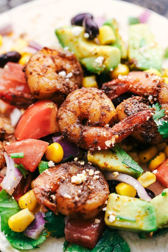 Blackened Cajun Shrimp Tacos with Avocado Salsa are made with so many fresh ingredients and the blackened cajun shrimp takes it to the next level with flavor!  These are some healthy and delicious tacos you have got to try!  I have officially joined the soccer mom club.  Well, lacrosse mom club.  Both of my boys …