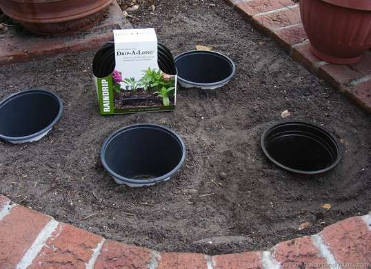 Genius! Switch out annual plants in your landscaping design by burying pots, then placing potted plants inside like this