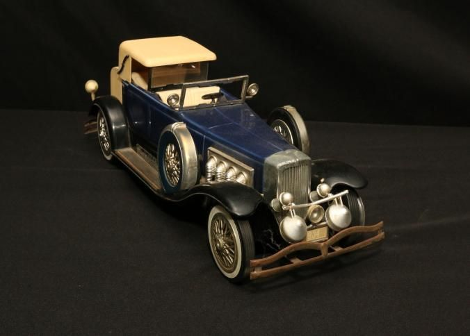 """Jim Beam decanters incl 1934 Duesenberg Model J blue in color 6"""" x 18"""" x 5.5""""T and 1928 Ford Model A Woody wagon brown in color 6.5"""" x 15.5"""" x 7""""T both having plaque on running board """"750mL Beam 80 proof Kentucky straight bourbon whiskey"""", also having wooden model truck 4"""" x 11.5"""" x 4""""T."""
