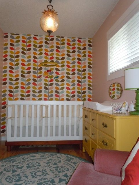 i am jealous that this baby gets to sleep with orla kiely wallpaper in her room.