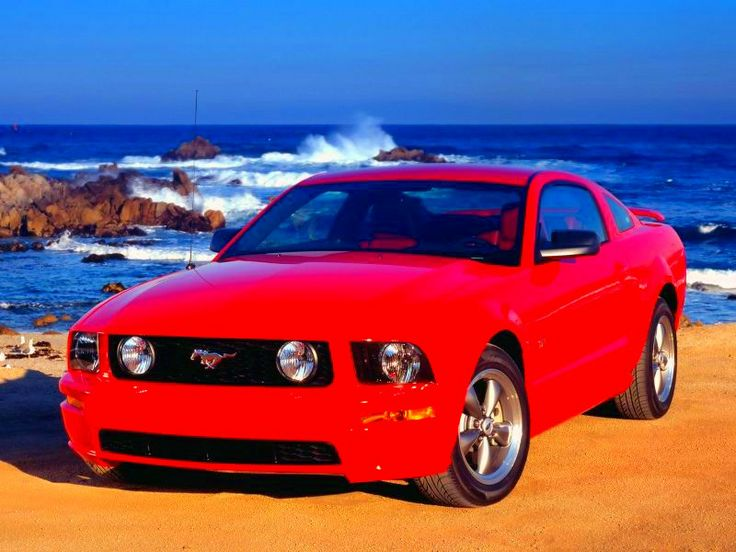 ford mustang rojo  para ir bien priti a la playa