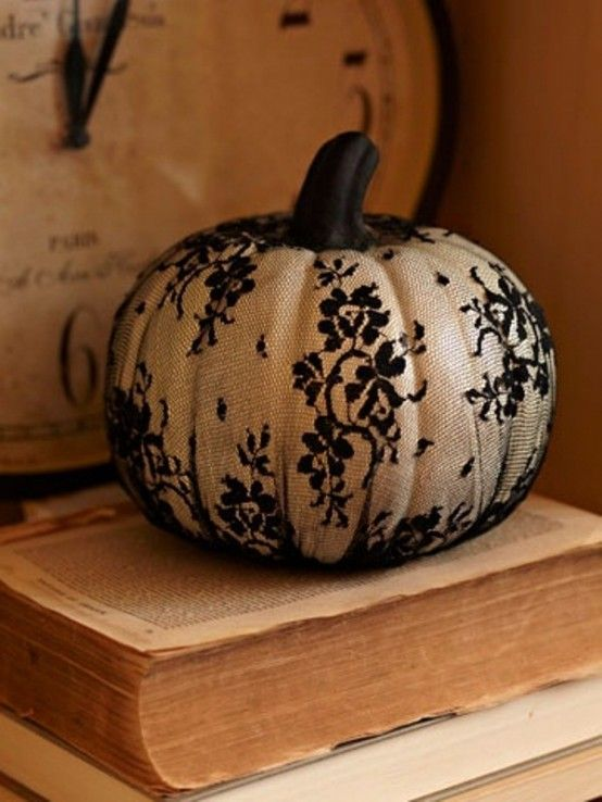 Easy and chic idea for Halloween decorating.  Use black lace to cover your pumpkin!