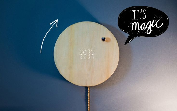 Design aus Schweden als Decor fuer die Wohnung: Die Uhr Story mit Kugel und Holz