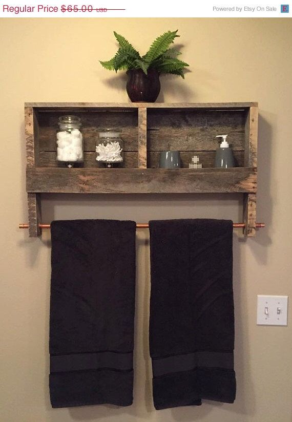 Rustic bathroom towel rack and storage shelf.